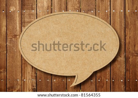 Blank Speech Bubble on wood background - stock photo