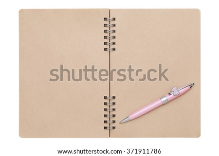 blank spiral brown notebook with ball point pen  - stock photo