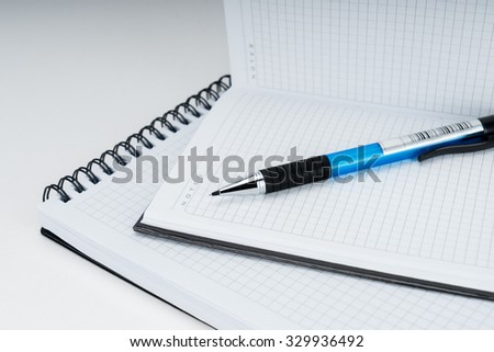 Blank spiral notebook notepad and pen on white background