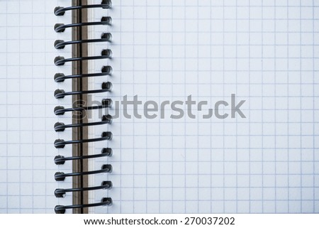 Blank spiral notebook on an oak wood table