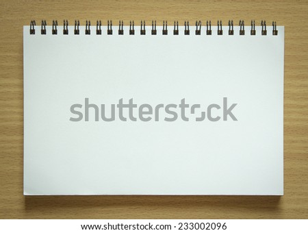 blank spiral notepad on wood background - stock photo