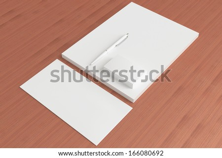 Blank Stationery ID Set on wooden background. Consist of Business cards, pen, letterhead and envelope.
