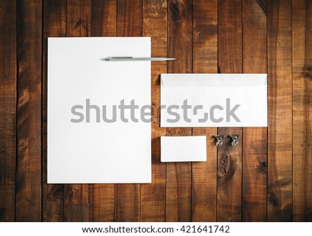 Blank stationery set on vintage wood background. Letterhead, business card, envelope and pen. Blank template for branding identity. Top view. - stock photo