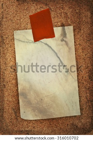 blank sticker glued red ribbon to a cork board  - stock photo