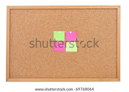 Blank sticky notes pinned on cork memo board in closeup over white background - stock photo
