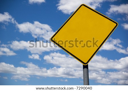 Blank street sign against a blue sky background - stock photo
