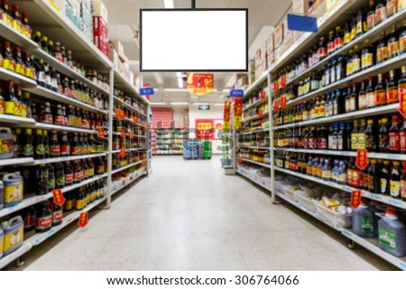 blank supermarket TV in blurry for background - stock photo