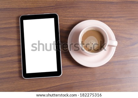 blank tablet and coffee at wooden table - stock photo
