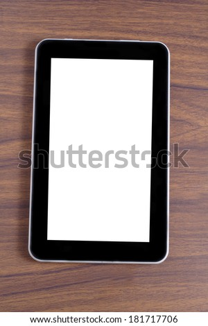 blank tablet at wooden table - stock photo