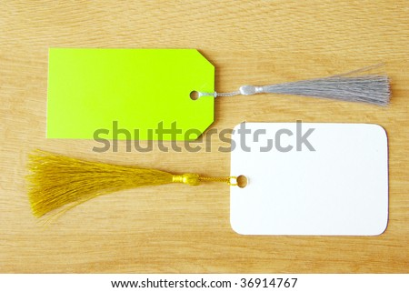 Blank tag isolated on a wooden background