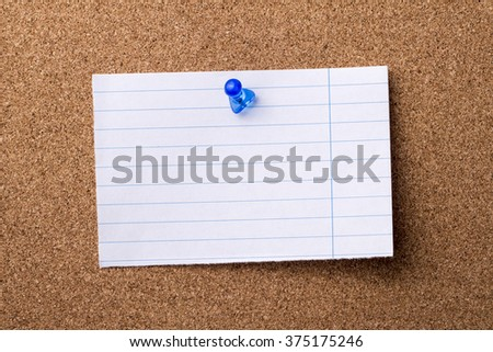 Blank teared note paper  pinned on bulletin board - horizontal image