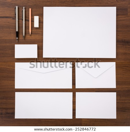 Blank Template. Consist of Business cards, letterhead a4, pen, envelopes,pencil,eraser on wood table - stock photo