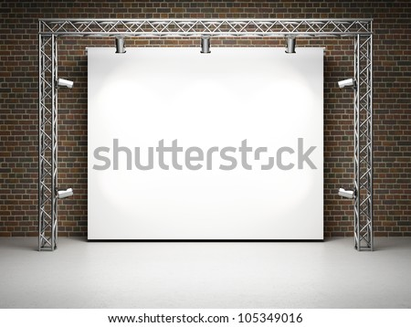 Blank trade exhibition stand with screen and spot lights on brick wall - stock photo