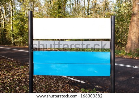 Blank traffic road sign in forest - stock photo