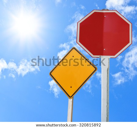blank traffic sign collections on white sky with sun - stock photo