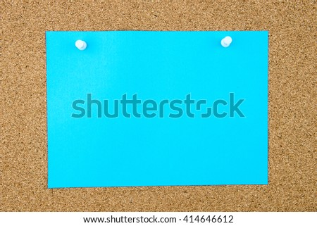Blank turquoise paper note pinned on cork board with white thumbtacks, copy space available - stock photo