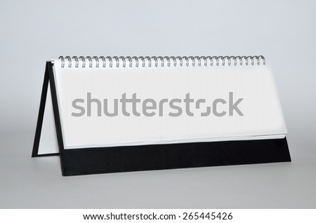 Blank vertical agenda with metal spiral and dark background - stock photo