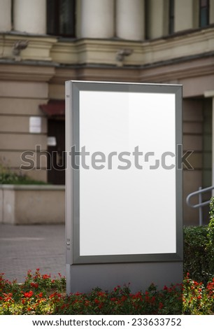 Blank vertical billboard. Clipping path. Shallow depth of field. - stock photo