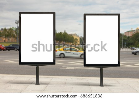 Blank vertical street billboard poster on city background. 3d illustration.