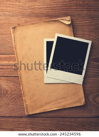 blank vintage paper and photo frame with space for your data on old wooden background - stock photo