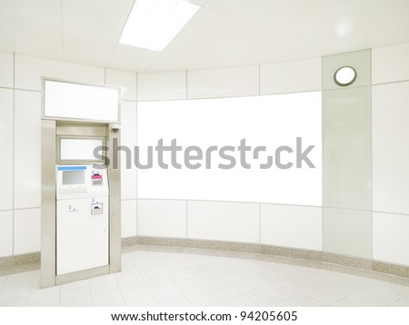 Blank wall and automated teller machine - stock photo