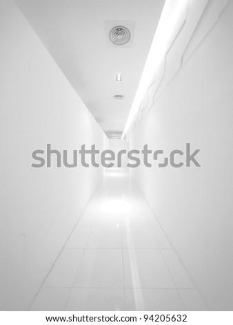 Blank wall and long walkway - stock photo