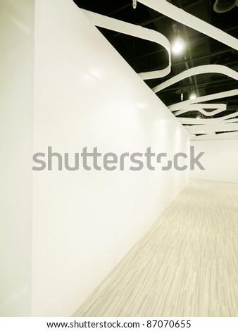 Blank wall and wooden walkway - stock photo