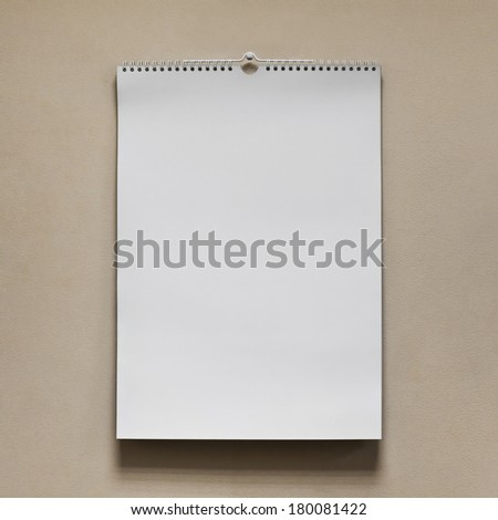 Blank wall calendar with spring on the texture background - stock photo
