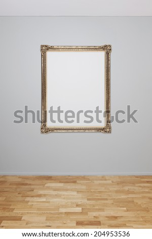 Blank wall interior with an empty frame - stock photo