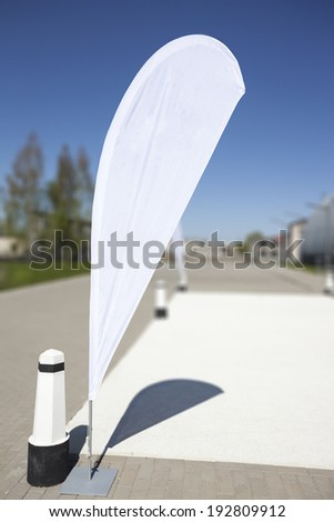 Blank white advertising flag or so called beach flag. - stock photo