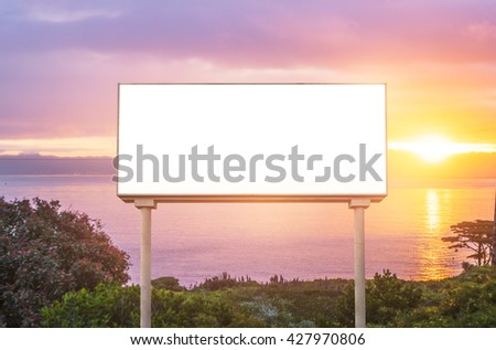 blank  white billboard for outdoor advertising  at sunset ,ready for product display montage,advertisement.