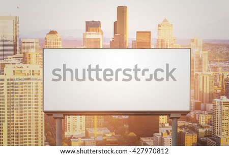 blank  white billboard for outdoor advertising  at sunset ,ready for product display montage,advertisement. - stock photo