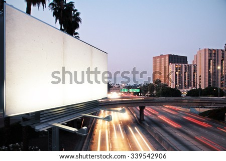 Blank white billboard on the background of the highway at evening, mock up - stock photo