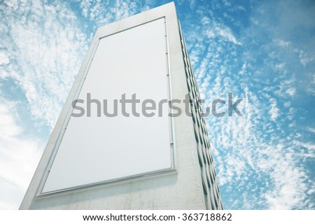 Blank white billboard on the wall of high building with blue sky, mock up - stock photo
