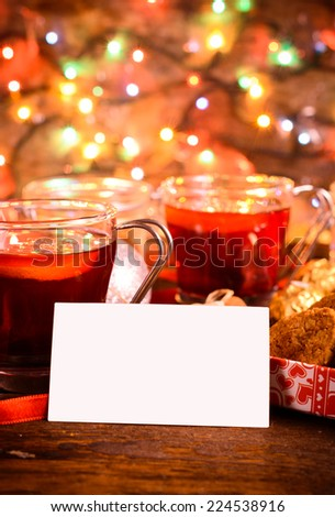 Blank white card with tea and cookies in background,selective focus  - stock photo