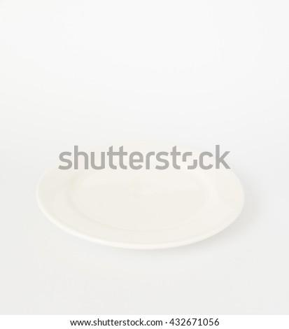 Blank white dish  on isolated white  background. - stock photo