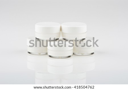 Blank white facial cream jar isolate on white background - stock photo