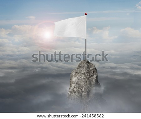 blank white flag on the mountain peak with sky cloudscape sunlight background  - stock photo
