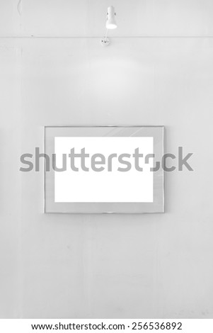 Blank white frame in art gallery with lamp - stock photo