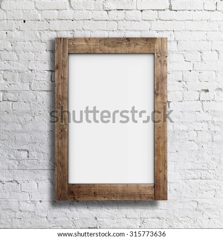 blank white frame on brick wall - stock photo