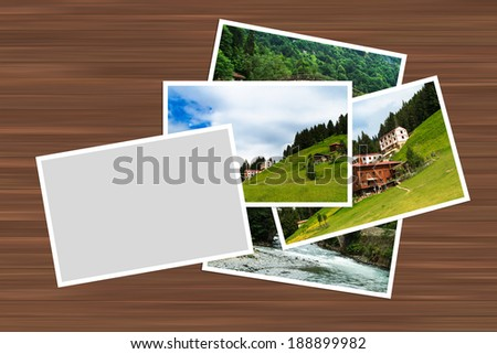 Blank white image frame with border for your photography on wooden table. - stock photo