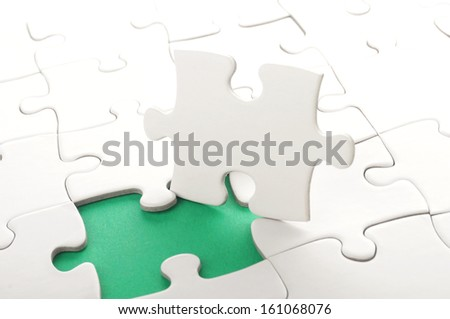 blank white jigsaw puzzle with missing piece - stock photo