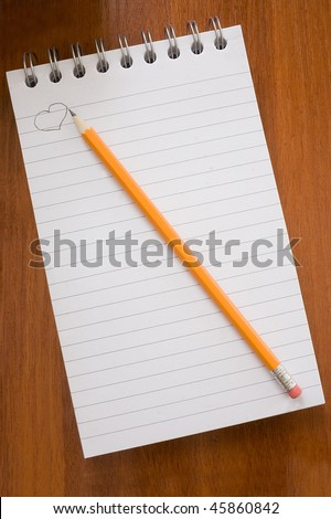 blank white notebook on table