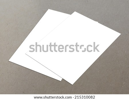 Blank white paper A4 fly-er collection on floor - stock photo