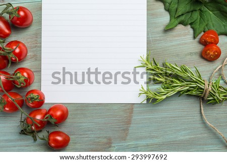 Blank white paper and fresh colorful vegetables on kitchen table