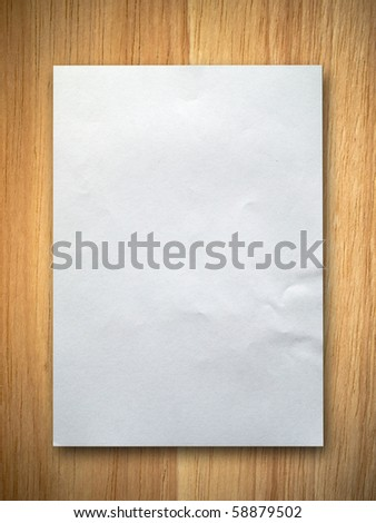 blank white paper on rubber wood background - stock photo