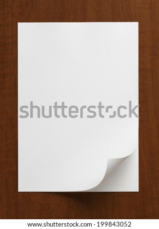 Blank White Paper Sheet?on a wooden table