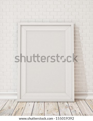 blank white picture frame on the wall and the floor - stock photo
