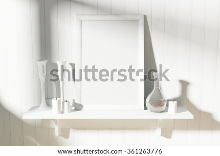 Blank white picture frame with candlesticks and decanter on white wooden shelf, mock up - stock photo
