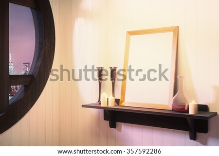 Blank white picture frame with candlesticks on brown wooden shelf at night, mock up - stock photo